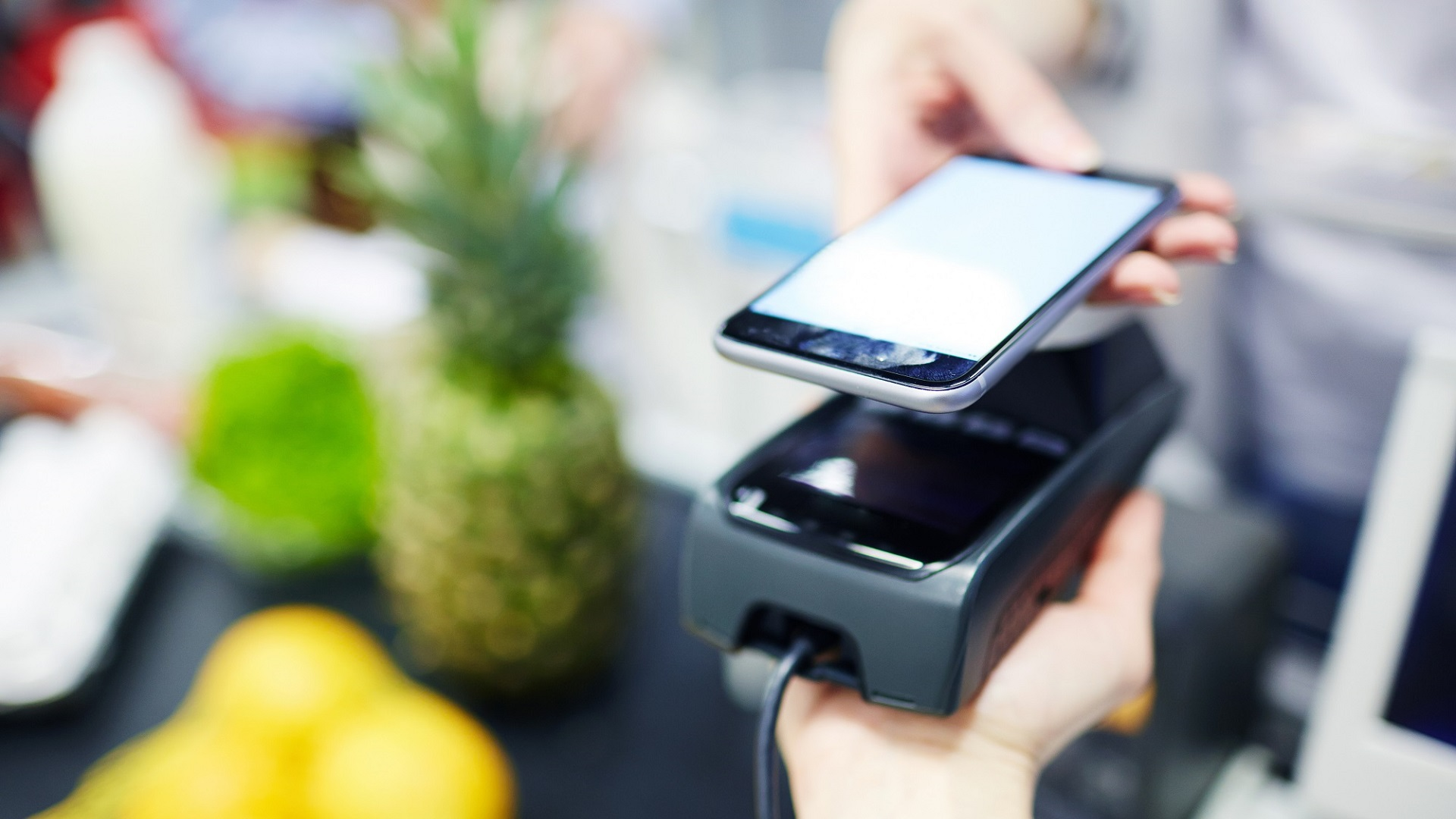 Customer using modern media technologies to make payment in supermarket